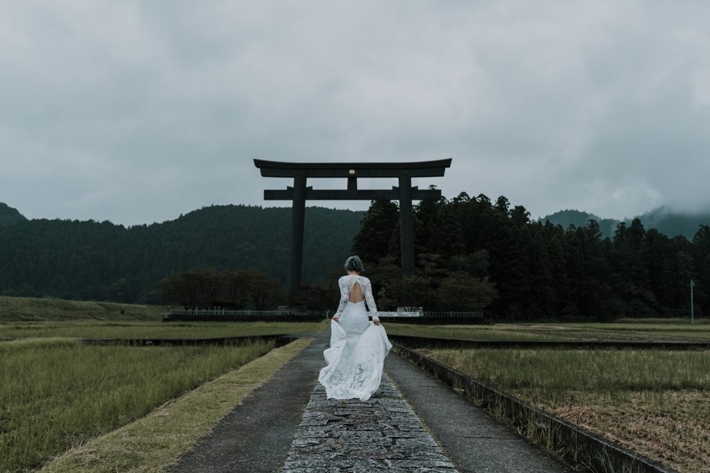 Melbourne bride running in Japan for her destinated travel wedding photos captured by award winning wedding photographers Black Avenue Productions